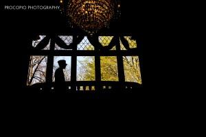 Groom on balcony, Procopio Photography
