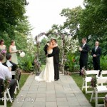 Wedding ceremony first kiss in garden, Artful Weddings by Sachs Photography
