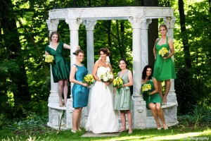 Bride and bridesmaids by gazebo, David Hartcorn Photography