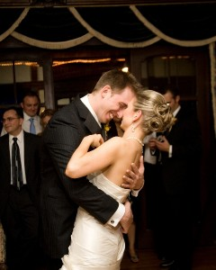 Bride and Groom Caressing One Another at Wedding Reception