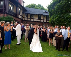 Bride and Groom Dancing Surrounded by Guests Outside Hamilton