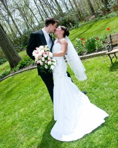 Bride and Groom in Garden Kissing Artistic Difference