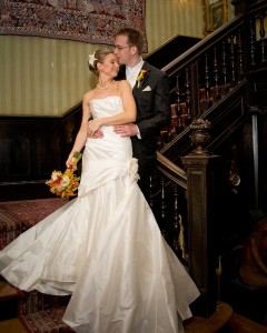 Bride and Groom Kissing on Stairwell