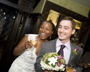Bride and Groom Smiling at Reception