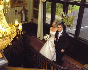 Bride and Groom Smiling for Camera on Balcony