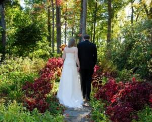 Bride and Groom Walking Up Walkway