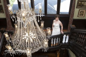 bride on staircase with chandelier Sachs