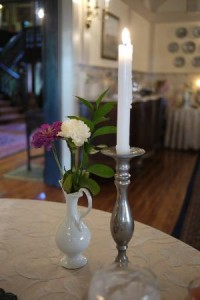 Candle and flower on dining room breakfast table