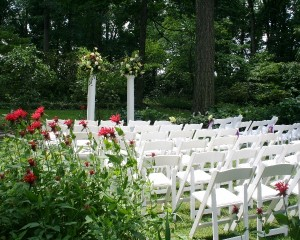 Carriage House garden ceremony in June