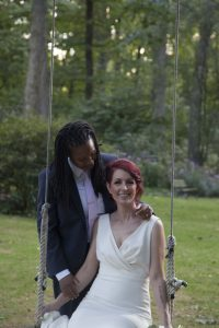 September Carriage House wedding | couple on swing | Gramercy Mansion