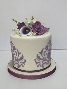 Lavender damask wedding cake with fondant icing